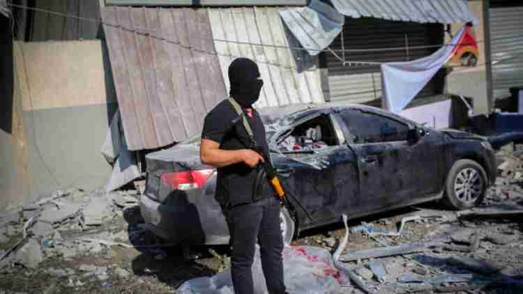 People gather around the home of Palestinian Islamic Jihad field commander Baha Abu Al-Atta after it was hit overnight by an Israeli strike in Gaza City on November 12, 2019. Photo by Hassan Jedi/Flash90 *** Local Caption *** ???????? ??? ????? ??? ????? ??? ????? ?????